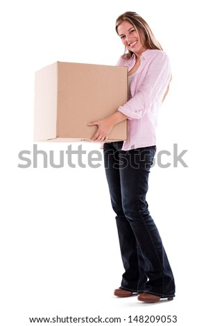 Happy woman moving and holding a box - isolated over white - stock photo