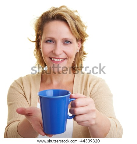 Happy woman offering a cup of coffee - stock photo