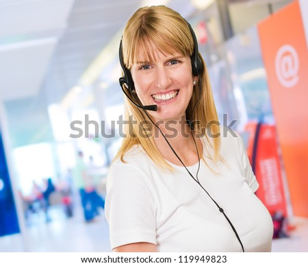 Happy Woman On Headset at an internet cafe, indoor - stock photo