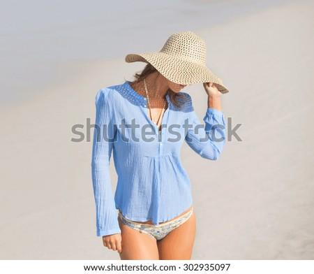 Happy woman on the beach - stock photo
