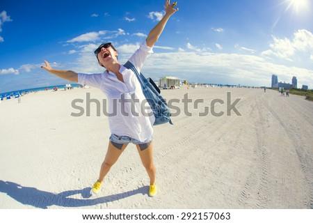 Happy woman on the beach, Miami - stock photo