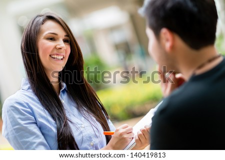 Happy woman on the street making a survey - stock photo