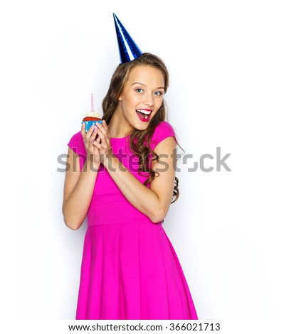 happy woman or teen girl with birthday cupcake - stock photo