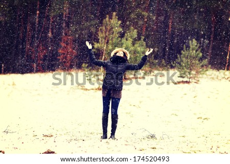 Happy woman playing outdoor with hands up - stock photo