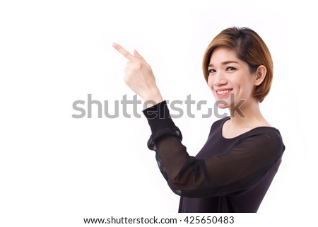 happy woman pointing hand and finger up to blank space, studio isolated of Chinese Thai asian woman model. - stock photo