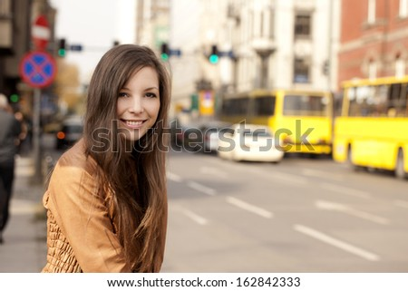 Happy Woman portrait street - stock photo