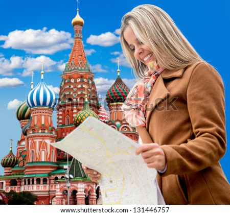 Happy woman seightseeing in Moscow and holding a map - stock photo