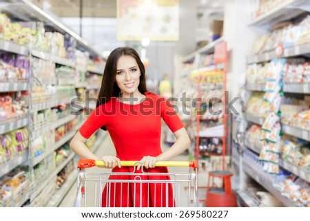 Happy Woman Shopping  at The Supermarket - Portrait of a young girl in a market store with a shopping cart  - stock photo