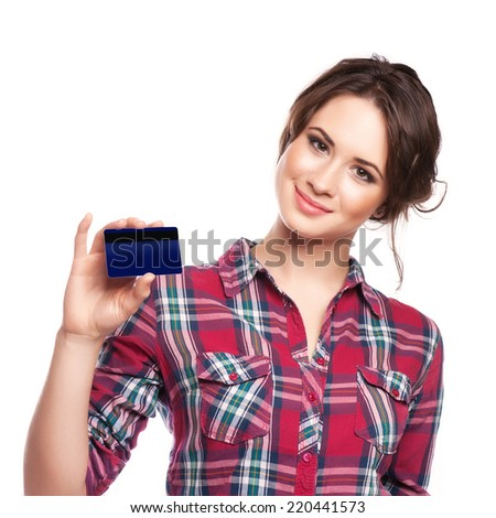 Happy woman shopping with a credit card - isolated over white - stock photo