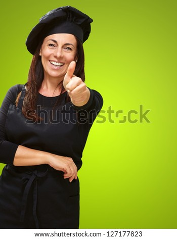Happy Woman Showing Thumb Up On Green Background - stock photo