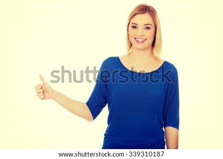 Happy woman showing thumbs up. - stock photo