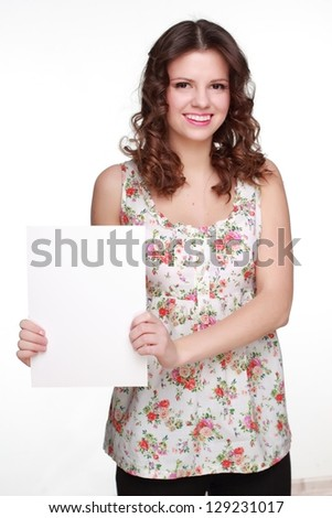 Happy woman showing white blank card - stock photo