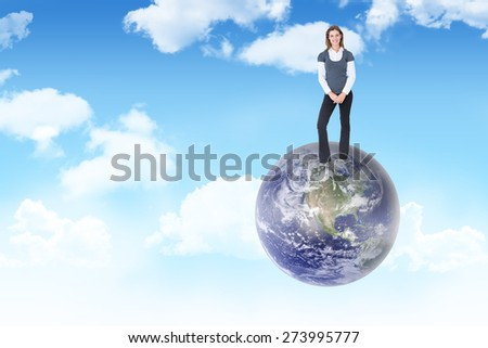 Happy woman smiling at camera against blue sky - stock photo
