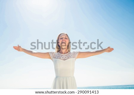 happy woman smiling at the beach - stock photo