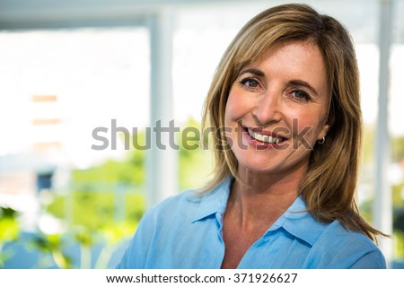 happy woman smiling at the camera - stock photo