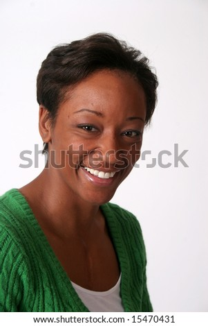 Happy woman smiling into the camera - stock photo