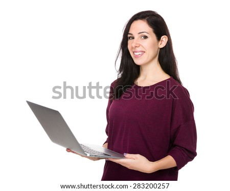 Happy woman use of laptop computer - stock photo