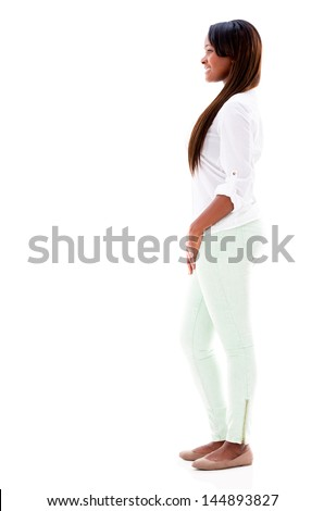 Happy woman walking to the side - isolated over white background - stock photo