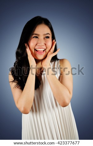 Happy woman wearing white dress looking at camera and dark blue background with clipping path - stock photo