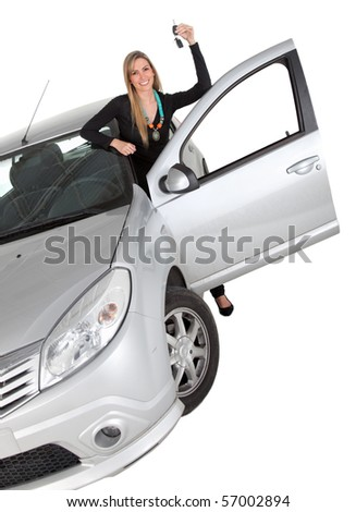 Happy woman with a car holding the keys ? isolated over a white background - stock photo