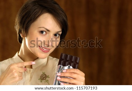 happy woman with a chocolate in his hands - stock photo