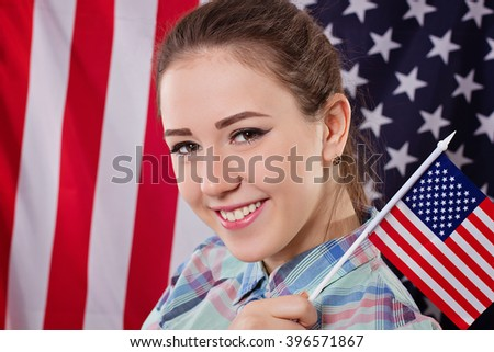 Happy woman with american flag, independence day concept - stock photo