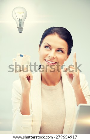 happy woman with cash euro money and light bulb - stock photo