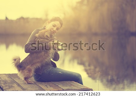 Happy woman with dog - stock photo