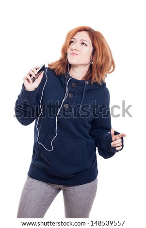 Happy woman with earphones listening music, isolated on white background. - stock photo