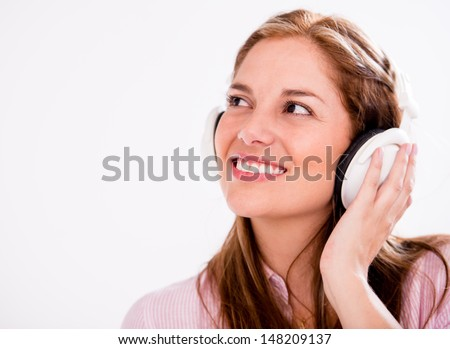 Happy woman with headphones - isolated over a white background  - stock photo