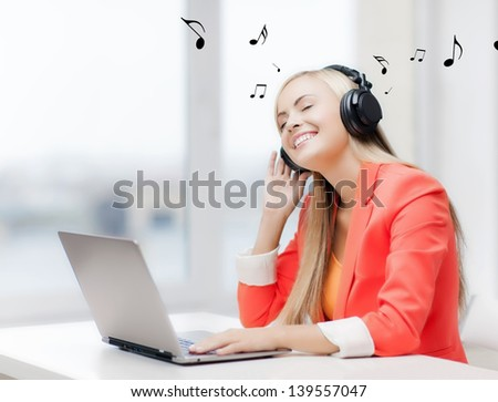 happy woman with headphones listening to music - stock photo