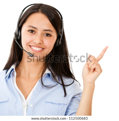 Happy woman with headset pointing - isolated over a white background - stock photo