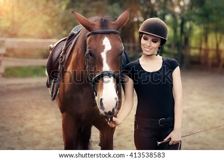 Happy Woman with her Horse - Beautiful young horsewoman next to her horse  - stock photo