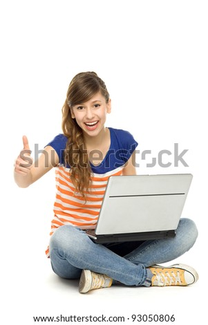 Happy woman with laptop showing thumbs up - stock photo