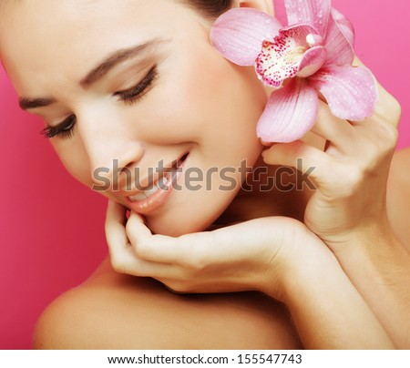 happy woman with orchid flower - stock photo