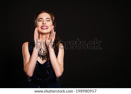 happy woman with perfect makeup wearing jewelry - stock photo