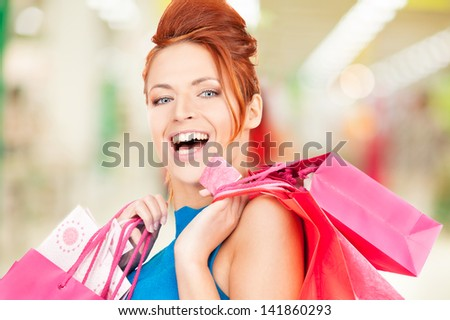 happy woman with shopping bags at the mall - stock photo