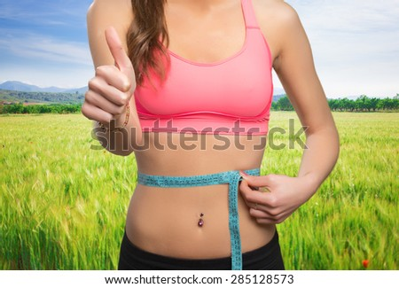Happy woman with the thumb up - stock photo
