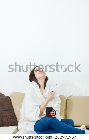 Happy woman with thermometer healed of colds, flu, fever and migraine in bed with cup of tea or coffee. Smiling girl finally feel better of headache virus. Concept of healing therapy and medication. - stock photo