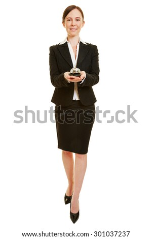 Happy woman working as concierge with hotel bell in her hands - stock photo