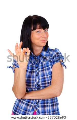 Happy woman 40 years old in blue checkered shirt, showing gesture OK - isolated on white background, positive human emotion, facial expression - stock photo