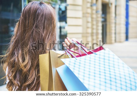 Happy Women holding shopping bags - stock photo