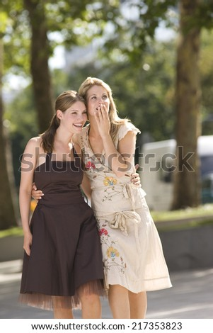 Happy women looking into distance with shocked expression - stock photo