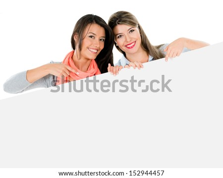 Happy women pointing at a banner - isolated over white background  - stock photo