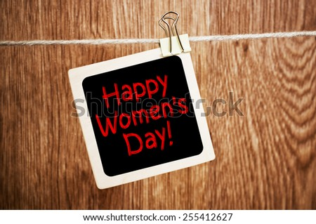 Happy Women's Day! written on a chalkboard - elegant image - stock photo