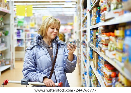 Happy women shopping in supermarket - stock photo