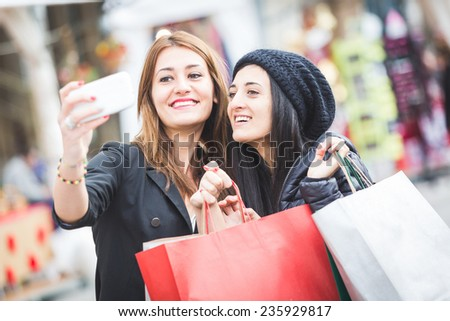 Happy Women Taking Selfie after Shopping - stock photo