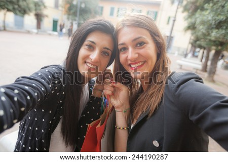 Happy Women Taking Selfie after Shopping. Taking Selfie and Sharing Photos on Social Networks is very common and fashion at the moment - stock photo
