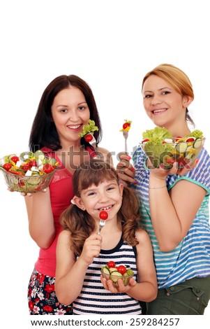 happy women teenage and little girl eat salad - stock photo