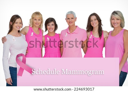 Happy women wearing pink for breast cancer awareness against pink card - stock photo